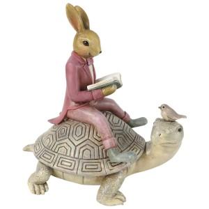 Zajačik v ružovom saku s knižkou v rukách sediaci na korytnačke z polyresinu 17x12x17 cm Clayre-Eef 33298